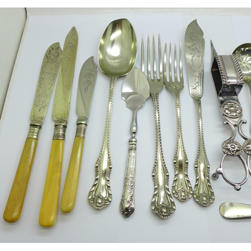 631 - A pair of plated candle snuffers, servers and other flatware...