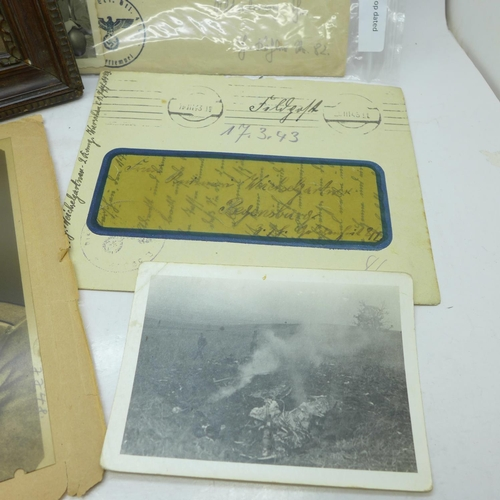 633 - Militaria; German WWII letters, photographs, a negative of a German soldier and a framed photograph...
