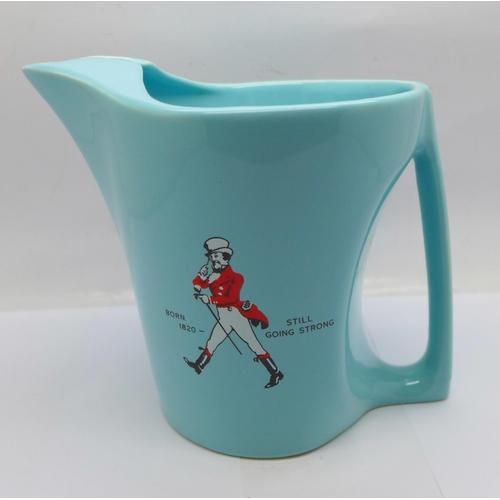 636 - A Wade Johnnie Walker water jug...