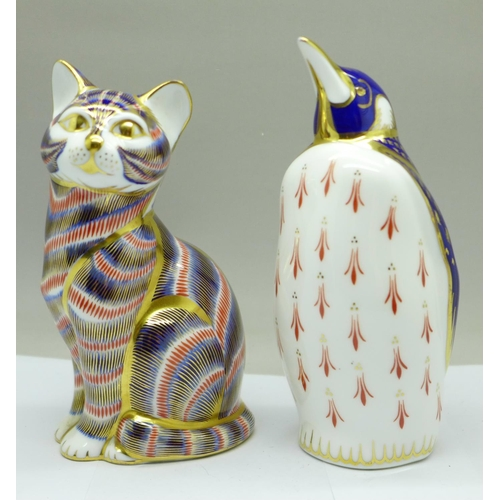637 - Two Royal Crown Derby paperweights, penguin and cat with silver stopper...