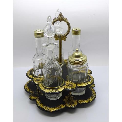 642 - A Victorian five bottle cruet (one bottle replaced) on a papier mache stand...