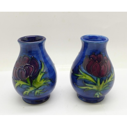 649 - A pair of Moorcroft Anemone vases, 9.5cm...