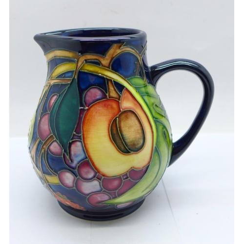652 - A Moorcroft Queens Choice jug, 12cm...