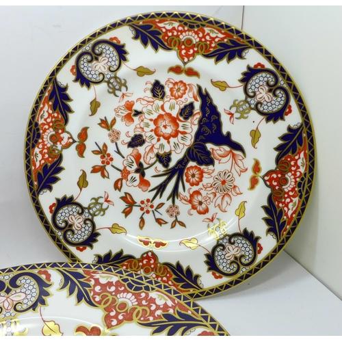660 - Three Royal Crown Derby plates...
