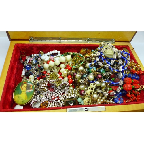 661 - A jewellery box and costume jewellery...