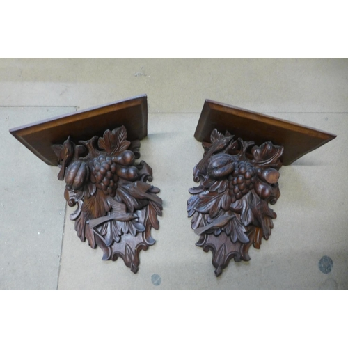 58 - A pair of 19th Century Black Forest carved softwood wall brackets...