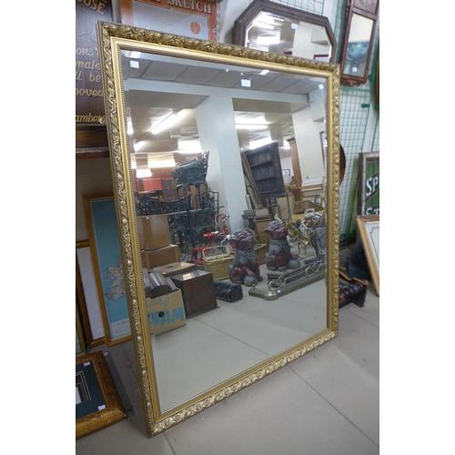 61 - A large gilt framed mirror, 132 x 102cms...