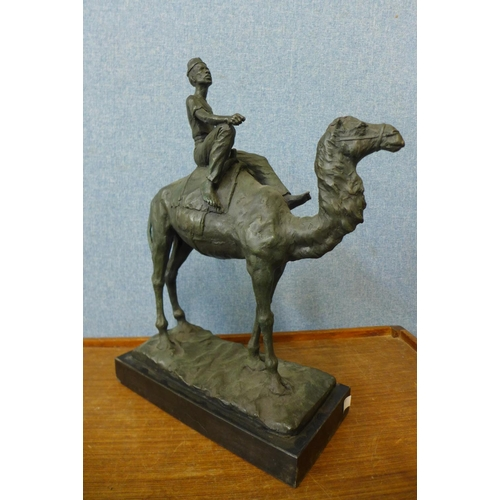 70 - A French style bronze figure of an Arab boy on a camel, on black marble plinth, 48cms h...