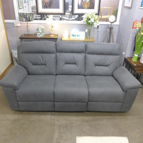 1312 - A Kuka fabric three seat power recliner sofa (4054-9) RRP £808.33 + VAT * this lot is subject to VAT...