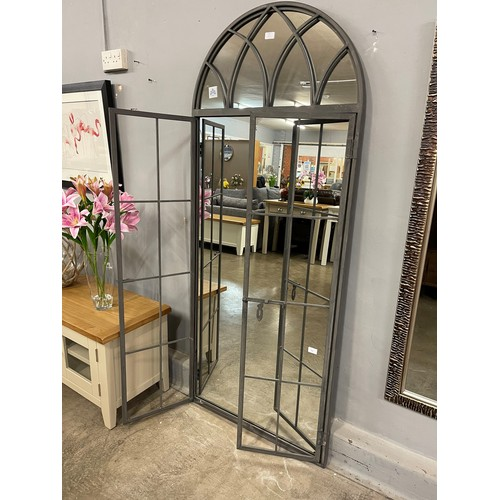 1314 - A large iron mirror in the style of an opening arched window, 185cms tall (MP1886)   #...