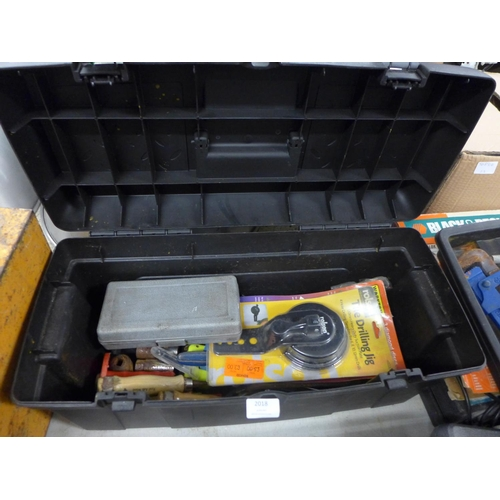 2018 - Black plastic tool box with a qty of hand tools inc chisels, tile drilling jig, bolt cutters, etc....