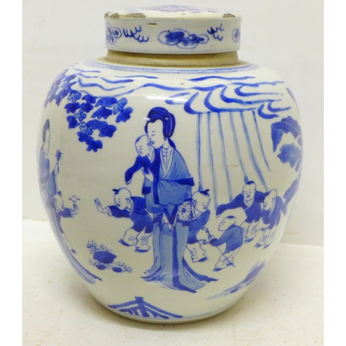 796 - A Chinese blue and white lidded jar decorated with women and children playing in a garden landscape,...
