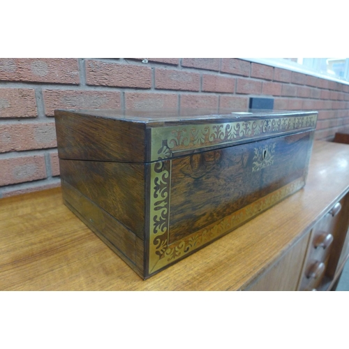 1 - A Victorian rosewood and brass inlaid writing slope