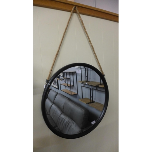 1320 - A circular black framed mirror with rope hanger, 58cms, (JRG1714)   #
