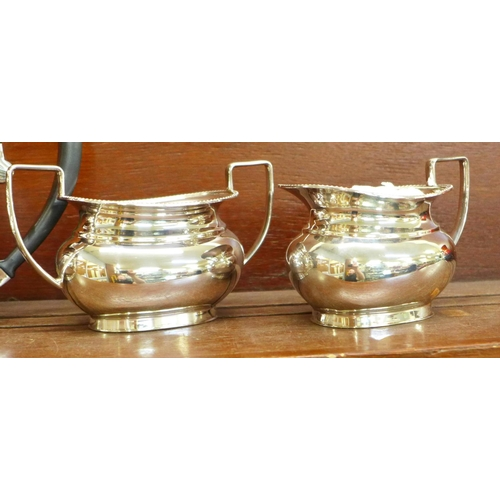 601 - A Garrard of London four piece silver plated teaset, boxed