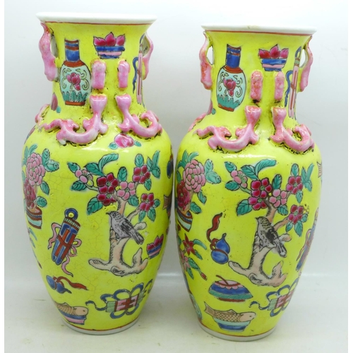 602 - A pair of Chinese vases, 21.5cm, crazed