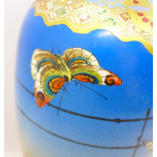 605 - A Japanese vase with gilt and enamel decoration, 20cm
