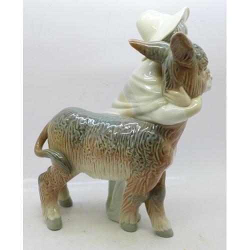 608 - A Lladro figure, boy with donkey, 21cm