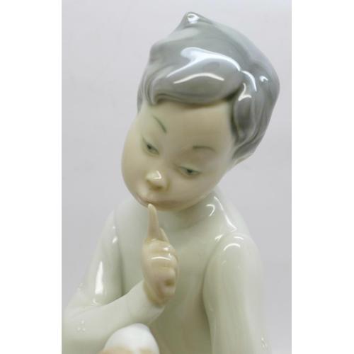 609 - A Lladro figures, boy with dog, 19.5cm