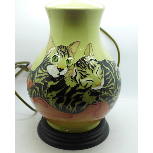 610 - A Moorcroft cat and mouse table lamp base, 28cm