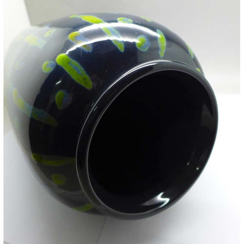 614 - Anita Harris Studio Pottery, contemporary trial vase with a green design on a deep blue ground, fact...