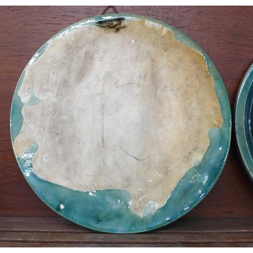 619 - A pair of Scottish Dunmore majolica plaques, 26cm