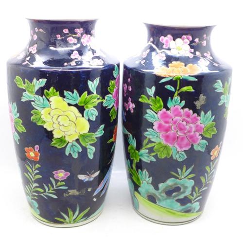 624 - A pair of Japanese famille noir vases, 24cm