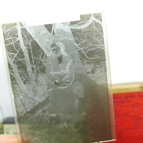 626 - Five boxes of glass plate negatives, circa 1900 - 1940, fifty-two plates in total