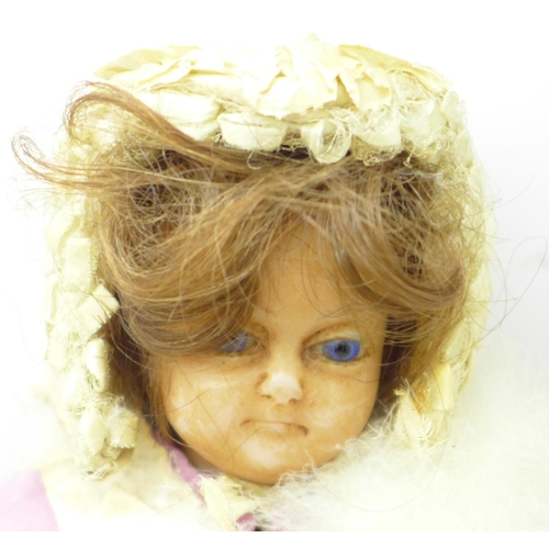 627 - A 19th Century doll with wax head and limbs with bonnet