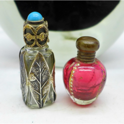 629 - Five perfume bottles including two miniature