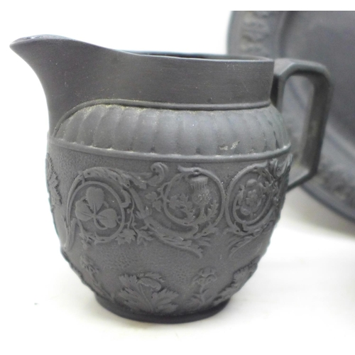 632 - Four pieces of black basalt; two jugs, one a/f, sugar bowl and oval plate