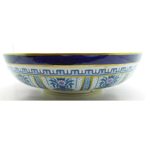 643 - A Losol ware Shanghai blue bowl, rim possibly restored