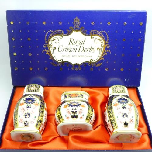 644 - A Royal Crown Derby Imari pattern cruet set, boxed