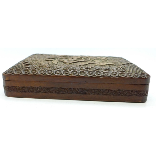 649 - A heavily carved wooden box