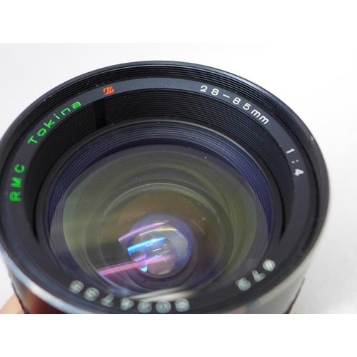 652 - A Tokina 28-85mm 1:4 camera lens for a Nikon ais mount and a pair of Jessops 12x50 binolcuars