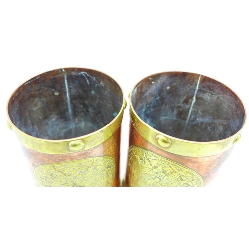 657 - A pair of Arts and Crafts brass and copper tankards
