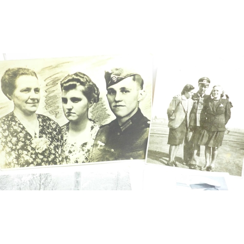 660 - Twenty-six WWII German photographs and twenty-five postcards, six letters and two Osterkommunion car...