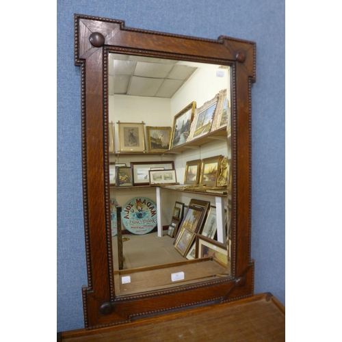 35 - An early 20th Century carved oak mirror