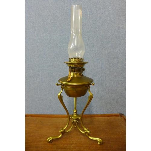 38 - An Art & Crafts brass oil lamp, manner of W.A.S. Benson