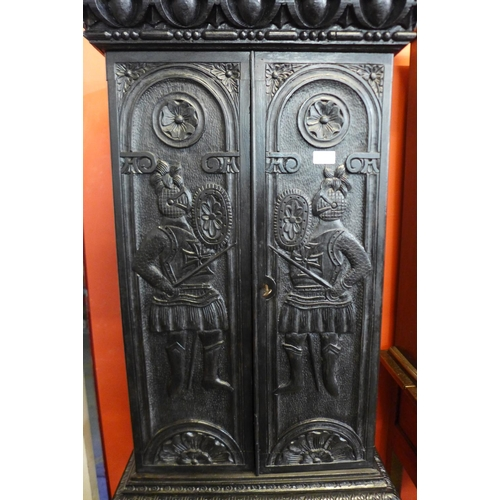 52 - A late 19th/early 20th century carved bog oak cupboard on stand