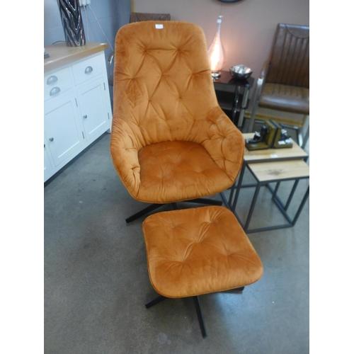 1302 - An orange velvet upholstered button-back swivel armchair and footstool (ex-display, slight marks)
