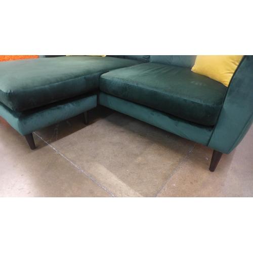 1304 - A green velvet upholstered corner sofa (ex-display, small tear to rear)