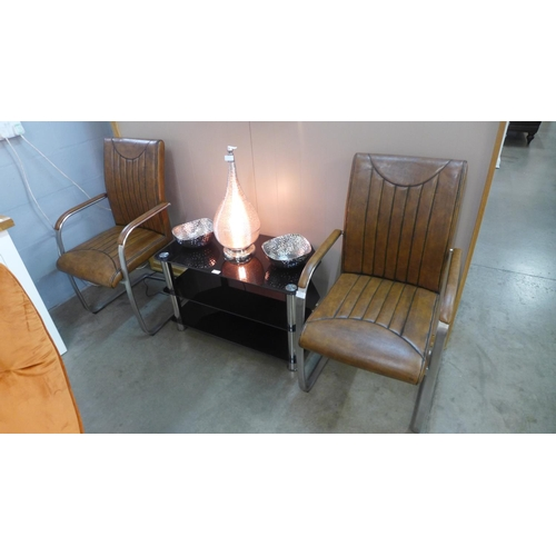 1315 - A pair of brown upholstered cantilever arm chairs