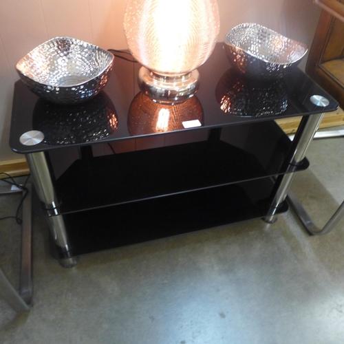 1316 - A black glass three tier TV/display stand (slight marks)