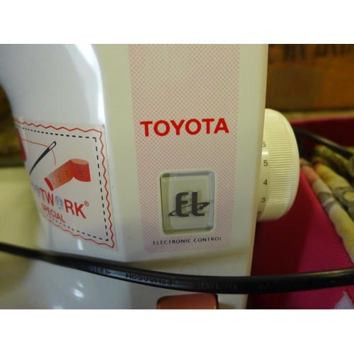 2038 - Toyota electronic sewing machine with foot pedal - W