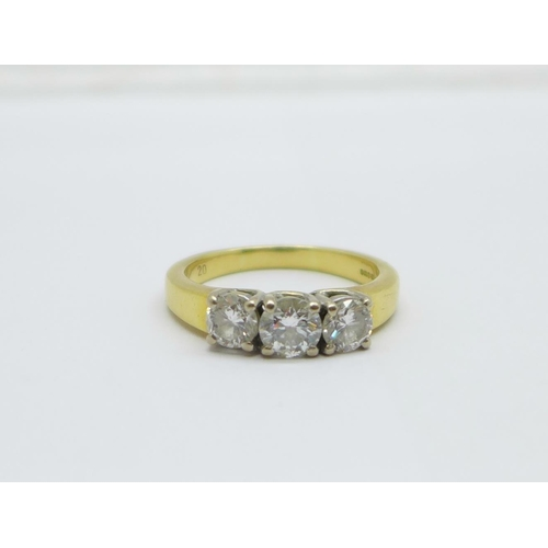 1298 - An 18ct yellow gold three stone diamond ring, approximately 1.25 carat total diamond weight, 8.6g, V