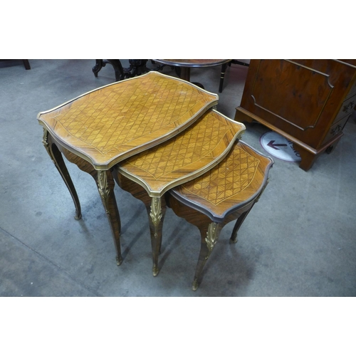 34 - A French Louis XV style parquetry inlaid rosewood and ormolu mounted nest of tables