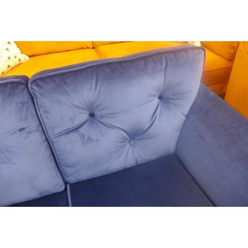 1336 - A royal blue velvet two seater sofa