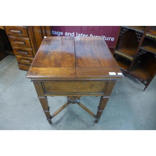 11 - A late Victorian oak metamorphic surprise drinks cabinet, Patent No. 7254