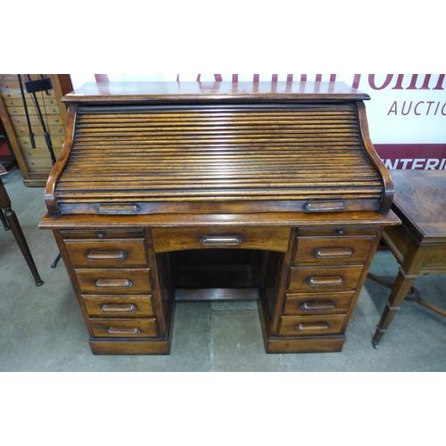 13 - An oak tambour roll top desk
